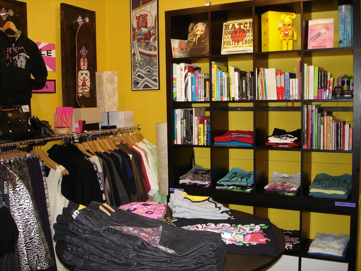 The back room in 2008 full of raw denim, graphic tees, and books.