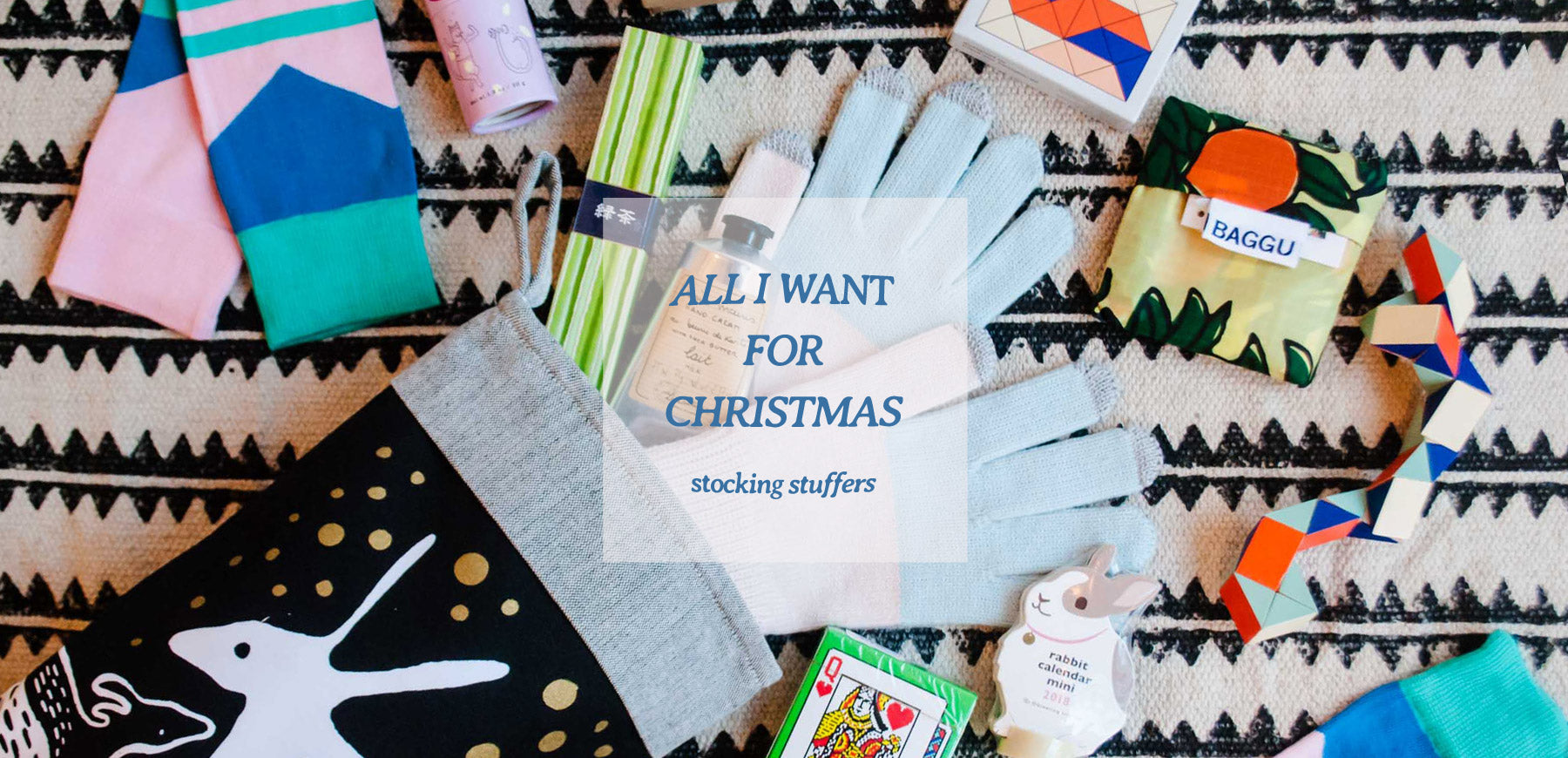 An image of a stocking with lots of cute small gifts coming out. Shop stocking stuffers below!