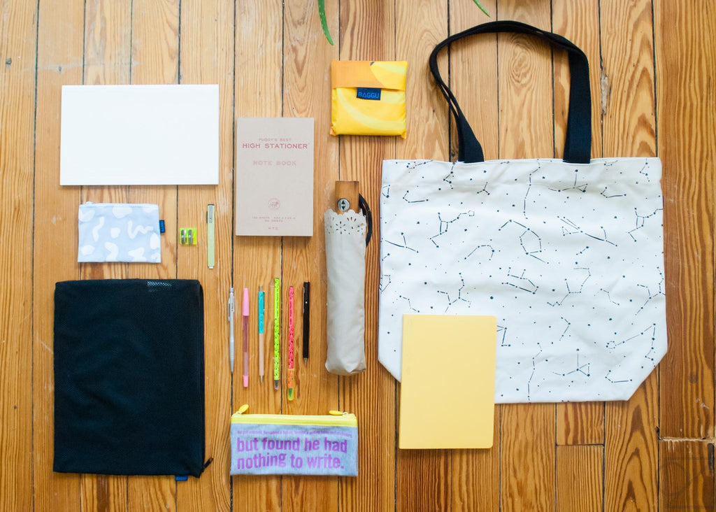 packing light for a day's errands with notebooks and tote