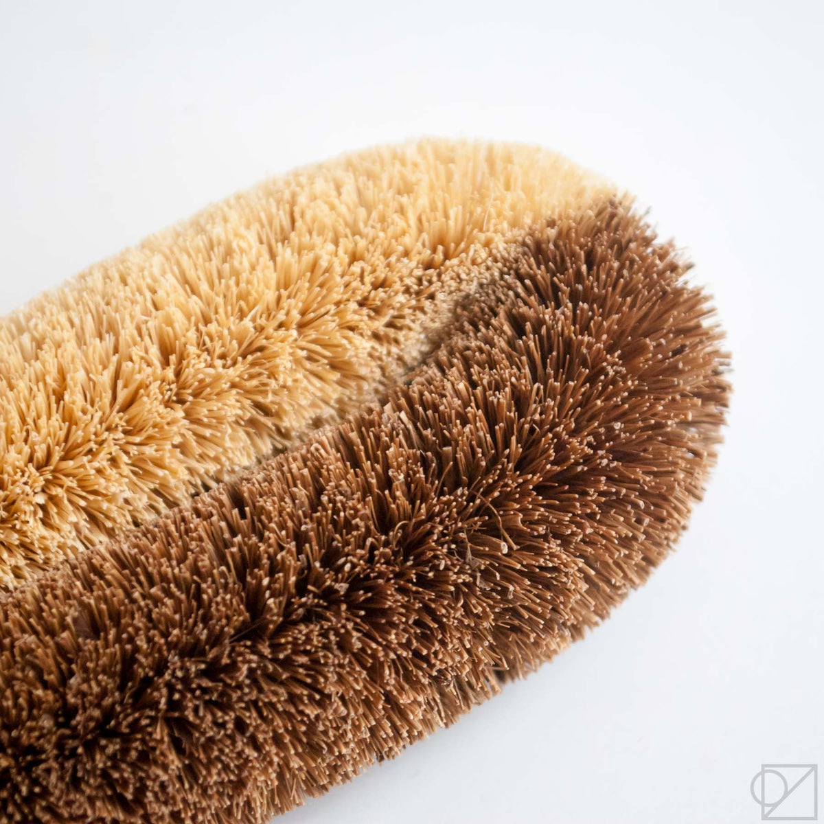 This scrub brush has half very stiff and half regular stiff palm fibers