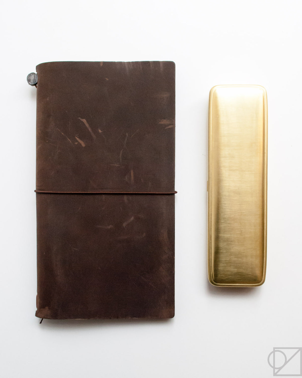 Midori Brass Pen Case size comparison with Traveler's Company journal
