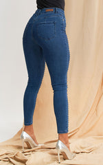 JEANS SKINNY CON STUDS