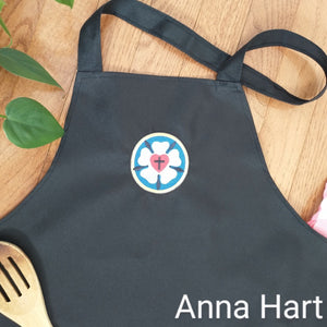 Anna Hart - Luther Rose on Black Apron