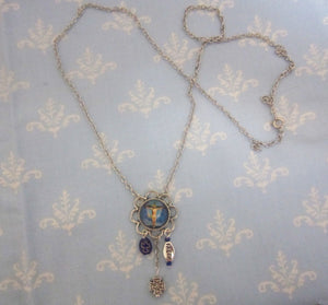 Kelly's Blue Crucifixion Necklace