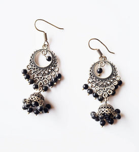 Oxidised silver jhumka theme earrings with black pearls