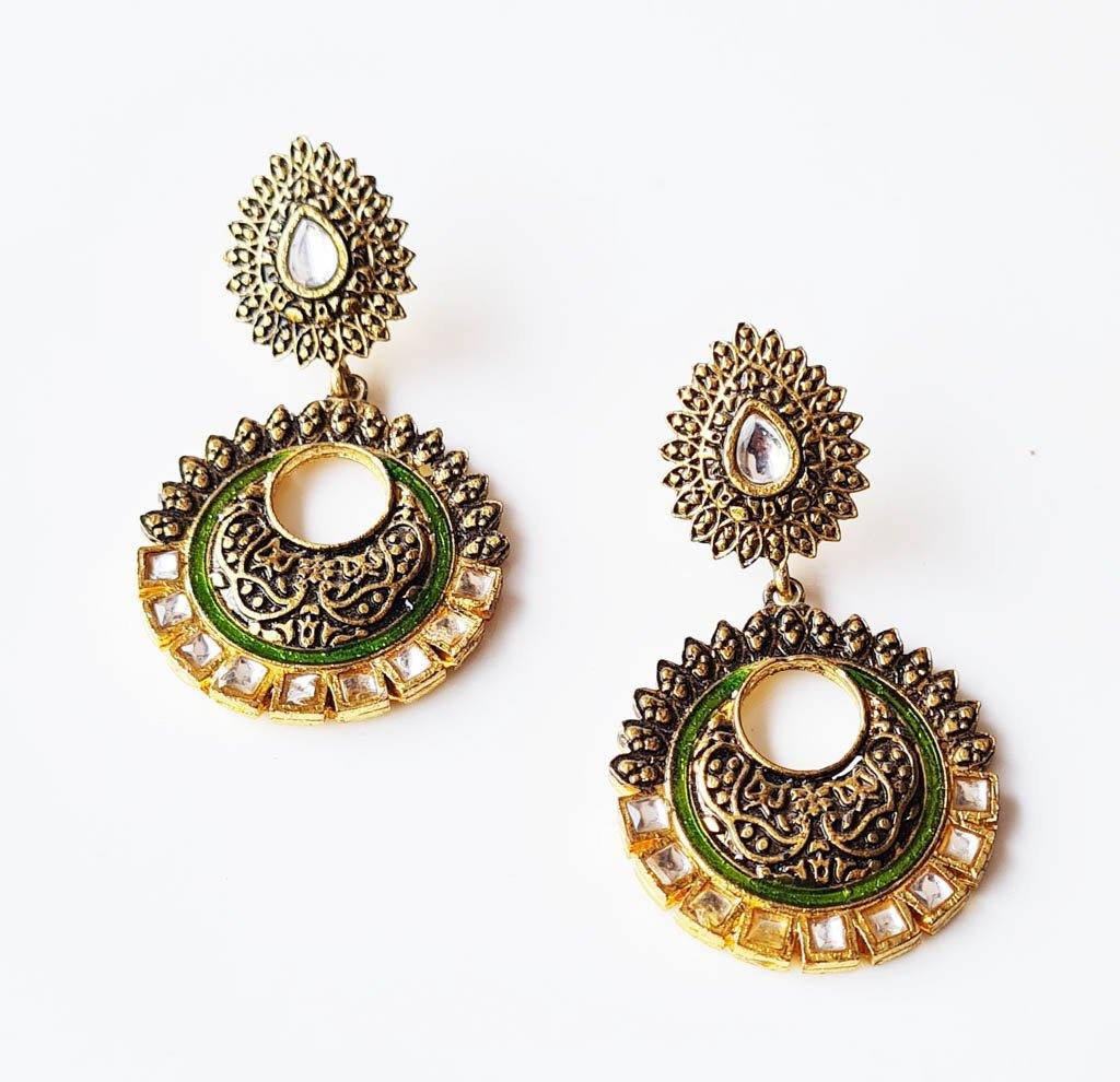 Golden tone oxidized earrings with white stone