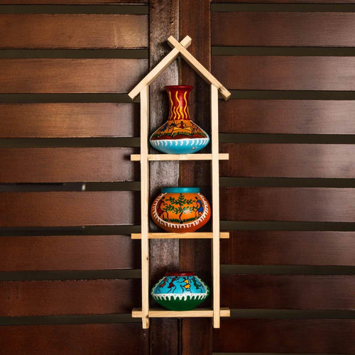 Three terracotta painted pots on the wall - Tribal theme - Paakhee - Handcrafting Dreams