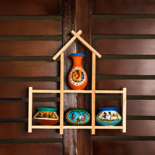 Four painted terracotta pots on the wall - Paakhee - Handcrafting Dreams