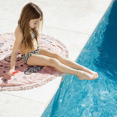 The Botanical Petite (kid/size) Roundie towel by the beach people