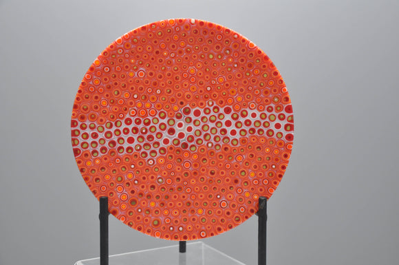 Orange and red murrine dish