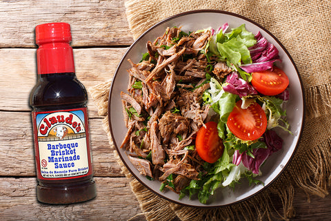 A Beef Brisket Salad and a 16oz bottle of Claude's BBQ Brisket Marinade