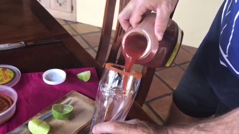Pouring Tank's Bloody Mary Mix into a beer glass