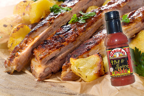 Claude's Sauces Hot and Spicy Sauce over grilled Hawaiian pork ribs.