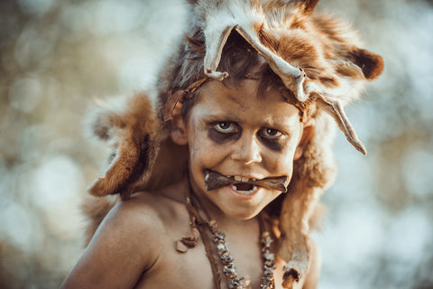 Boy dressed as a savage caveman