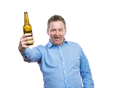 Drunk man holding beer bottle