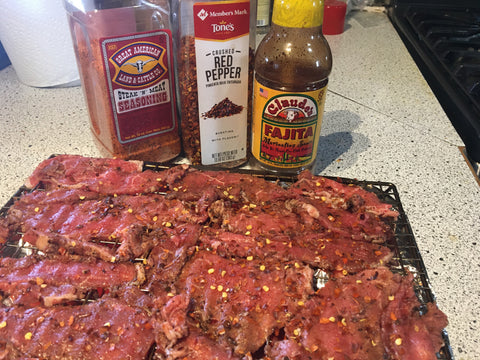 Cut strips of beef marinated with Claude's Fajita Marinade and prepared with Great American Seasoning