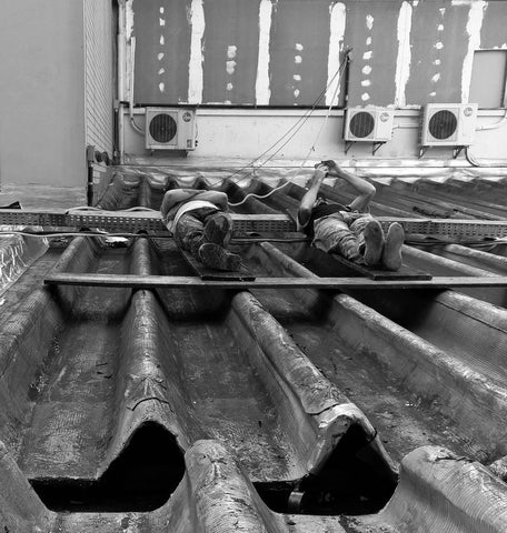 men-laying-on-metal-rooftop Protection Of Fasteners