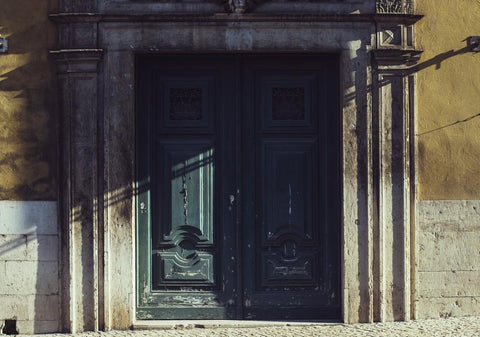 the-door-of-a-historical-building-catching-the-light