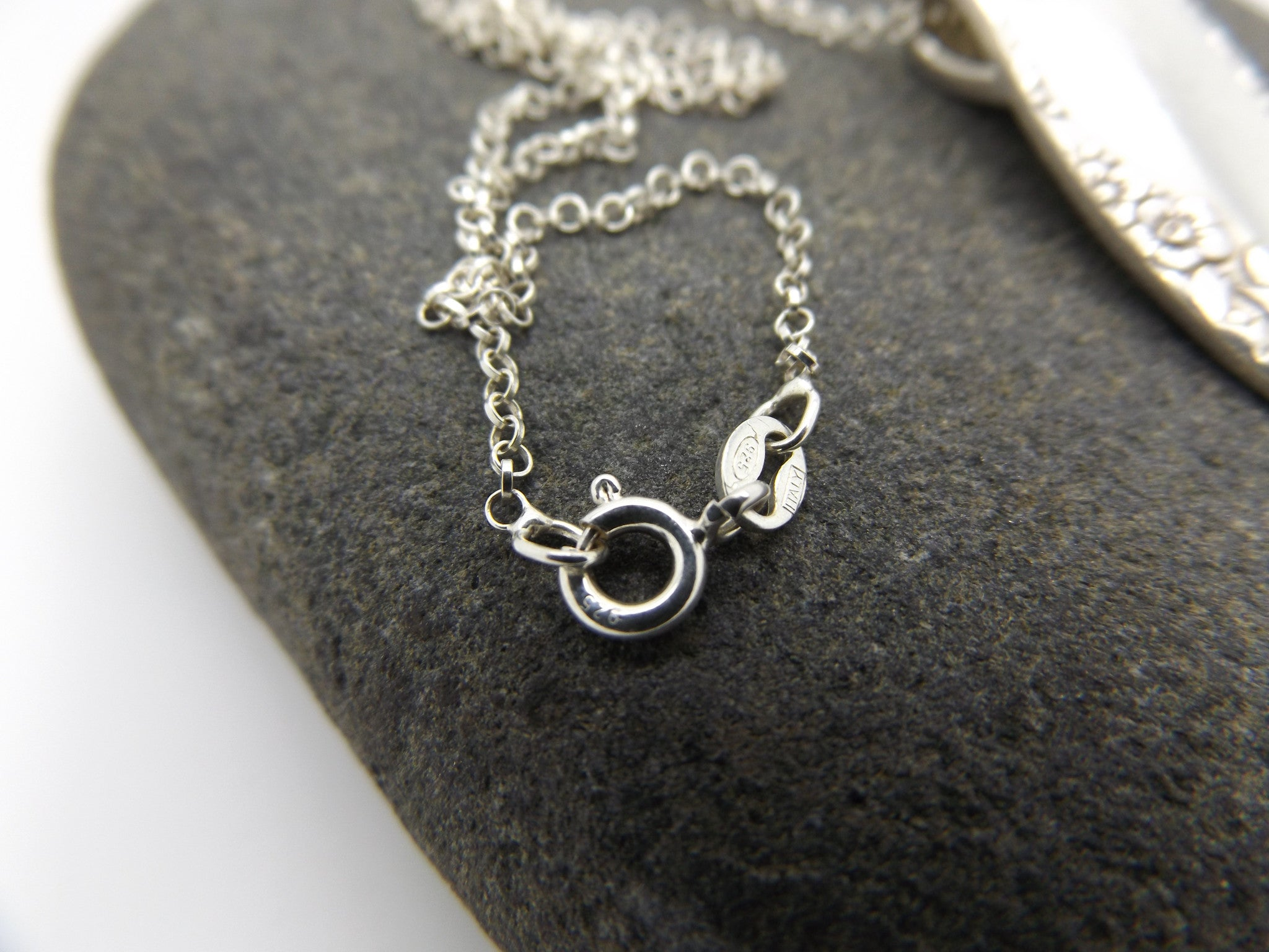 Spoon handle pendant upon sterling silver chain