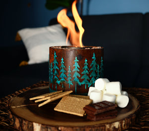 S'mores fire pit with a forest design