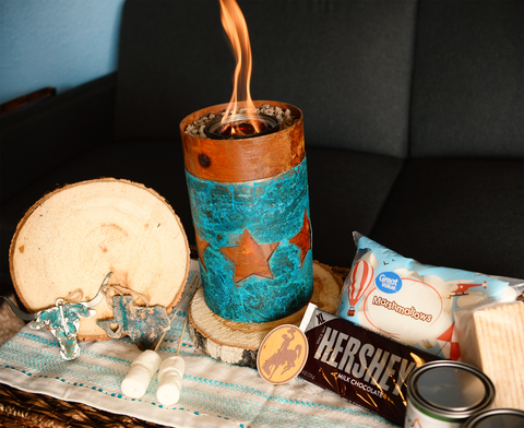 Tabletop fire pit with star design and s'mores kit, wood slices, and ornaments