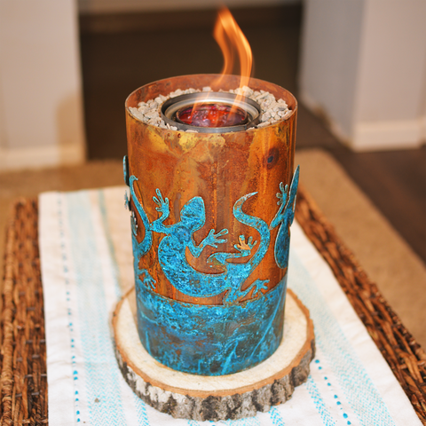 Small tabletop fire pit with lizard design in patinated copper