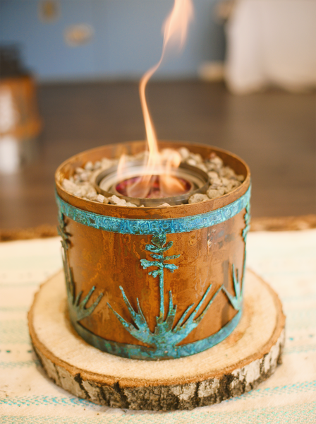 Small fire pit with blue yucca design on table