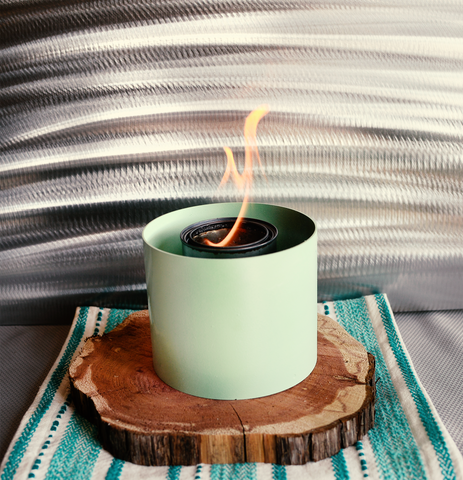 Small indoor fire pit in mint green color
