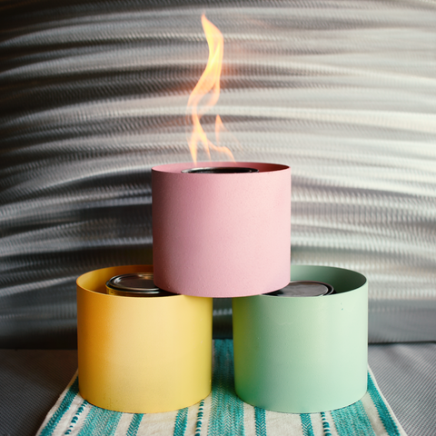 Three indoor fire pits in pastel easter colors