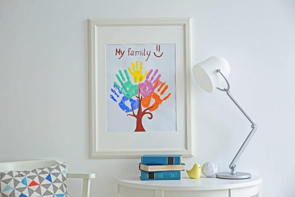 Framing children's art - Family hand prints in frame