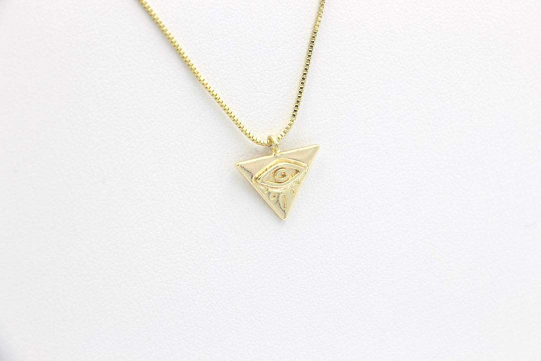 "AW Boutique's gold filled 15.5 inch box chain necklace featuring a dainty Eye of Providence, or the ""all seeing eye"", charm."