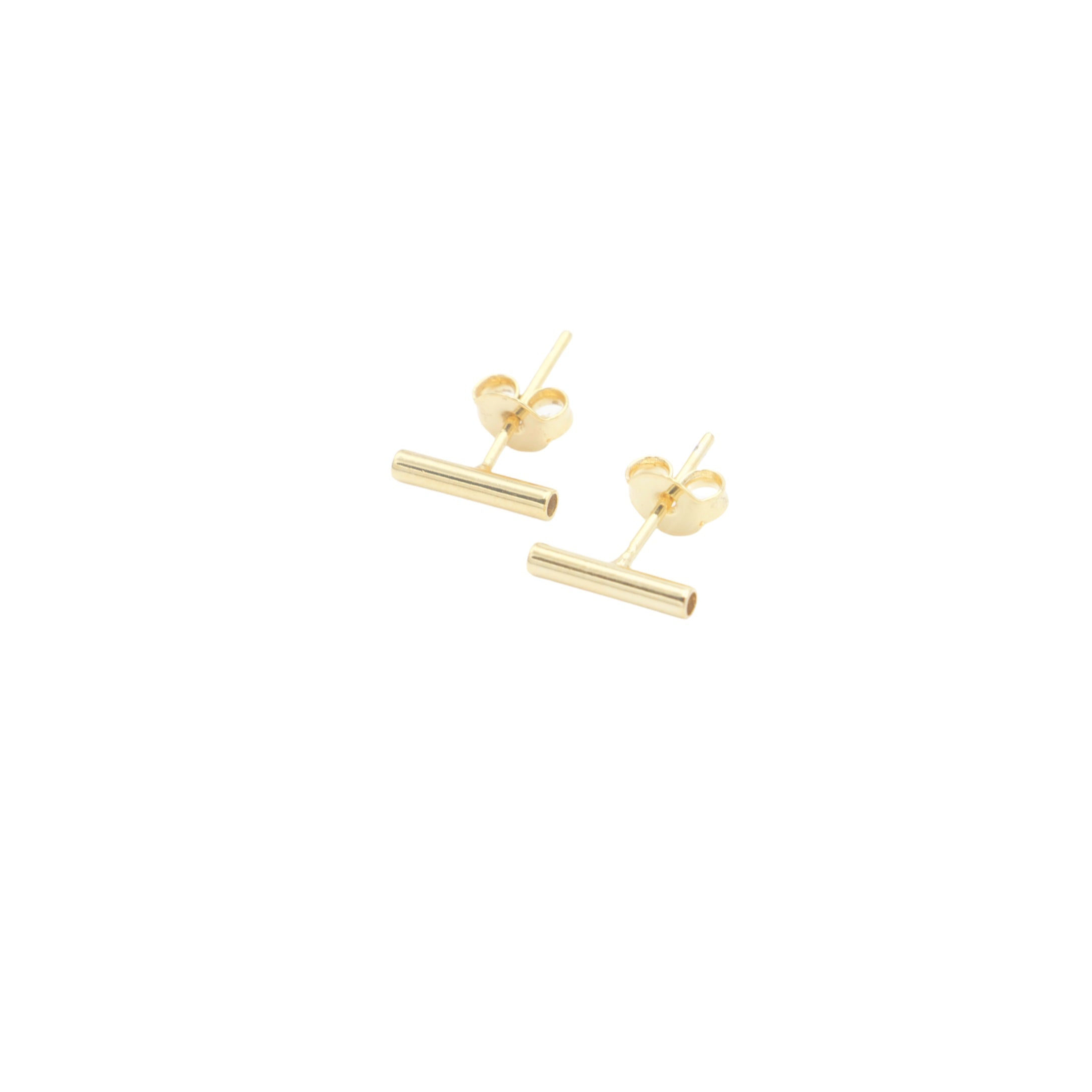 If you're an earring lover you have to own a pair of AW Boutique's Bar Stud Earrings!  These are a must have that can be worn alone or layered across multiple piercings.  The hollow design makes them a unique piece that sits comfortably against the ear, and can be worn either vertically or horizontally.