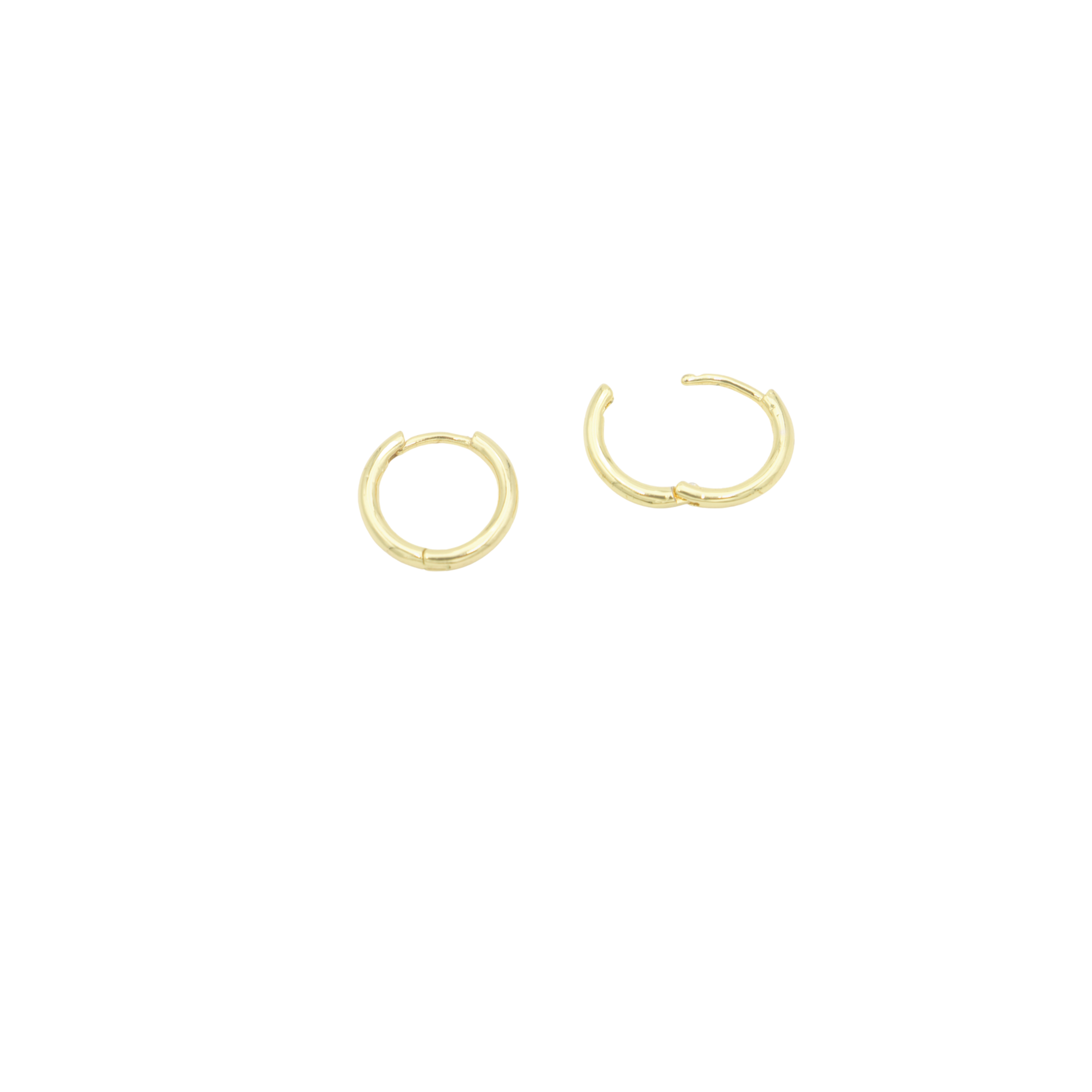 AW Boutique's 14mm diameter Everyday Sleeper earrings are a stylish take on the traditional sleeper, and also the perfect earring to layer across multiple piercings.
