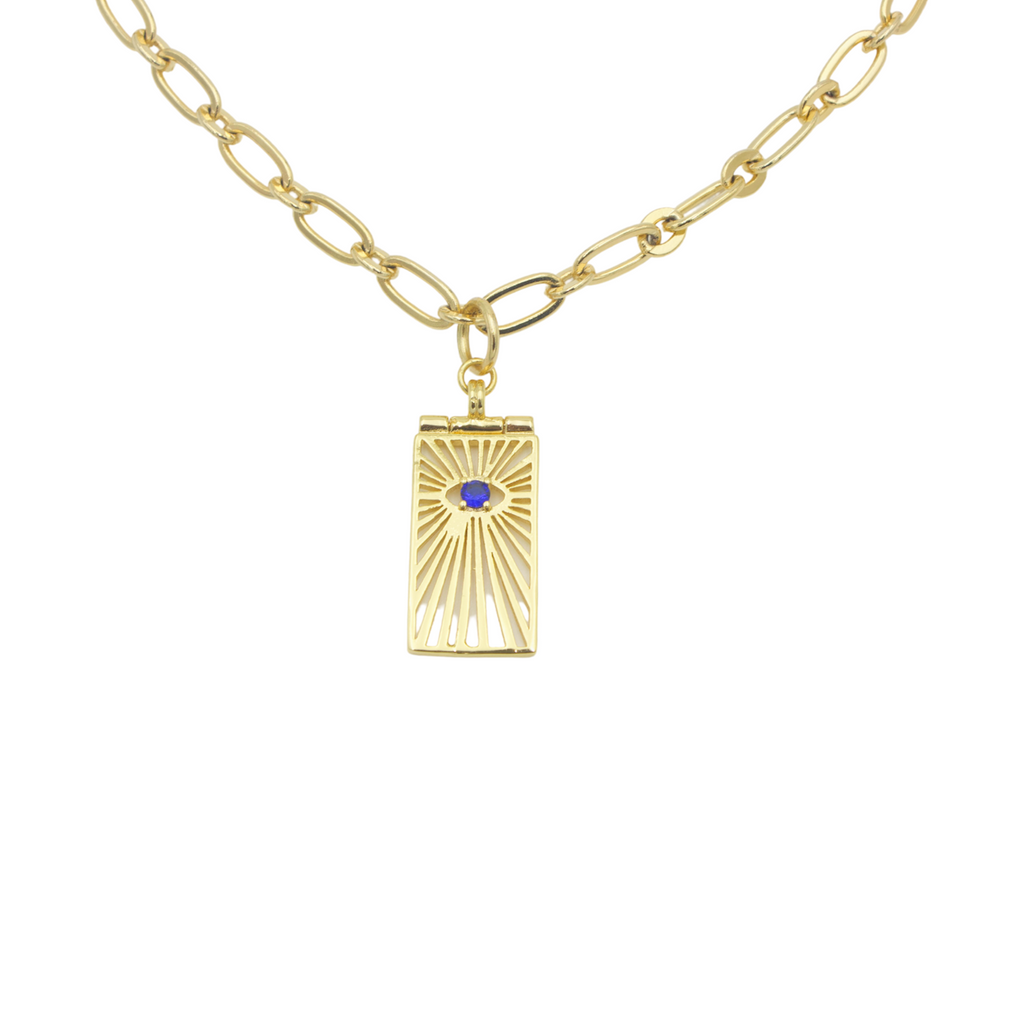 AW Boutique's gold filled unique 16 inch oval link chain necklace with a tag pendant featuring the Evil Eye with a sunburst effect surrounding it.