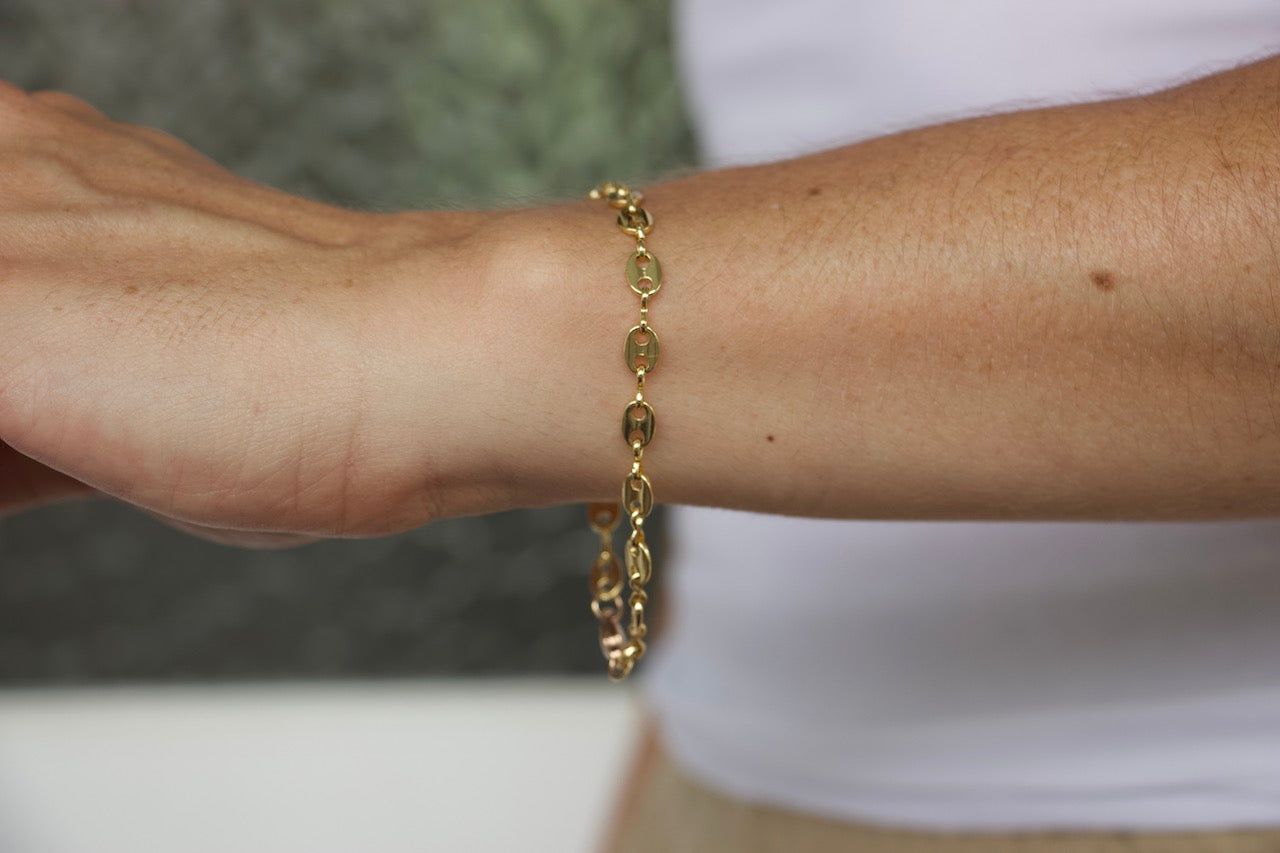 Model wearing AW Boutique's classic Gucci Link Bracelet.  This bracelet is both delicate and striking.  This is a piece that you can literally grab and go with.  You can wear it alone as an everyday go-to, or mix and layer it with your other bracelets for a beautiful stacked look.  Either way, this is definitely a staple.