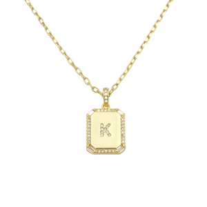 AW Boutique's gold filled 16 inch cable chain necklace finished with a dainty initial pendant with cubic zirconia detail. K initial shown.