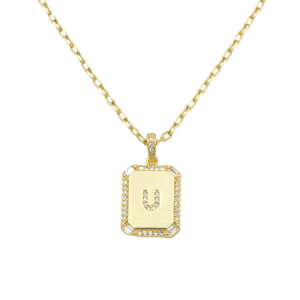 AW Boutique's gold filled 16 inch cable chain necklace finished with a dainty initial pendant with cubic zirconia detail. U initial shown.
