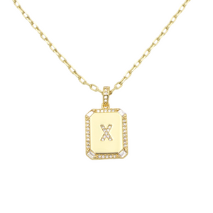 AW Boutique's gold filled 16 inch cable chain necklace finished with a dainty initial pendant with cubic zirconia detail. X initial shown.