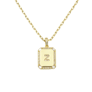 AW Boutique's gold filled 16 inch cable chain necklace finished with a dainty initial pendant with cubic zirconia detail. Z initial shown.