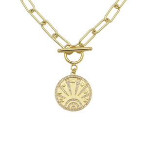 AW Boutique's gold filled 18 inch bold paper click oval chain necklace with a front toggle clasp and lucky coin medallion featuring 7 lucky symbols.