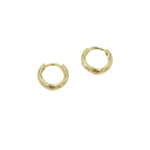 AW Boutique's gold filled mini everyday huggie hoops (12mm diameter) are perfect worn alone or layered with our other earrings across multiple piercings.