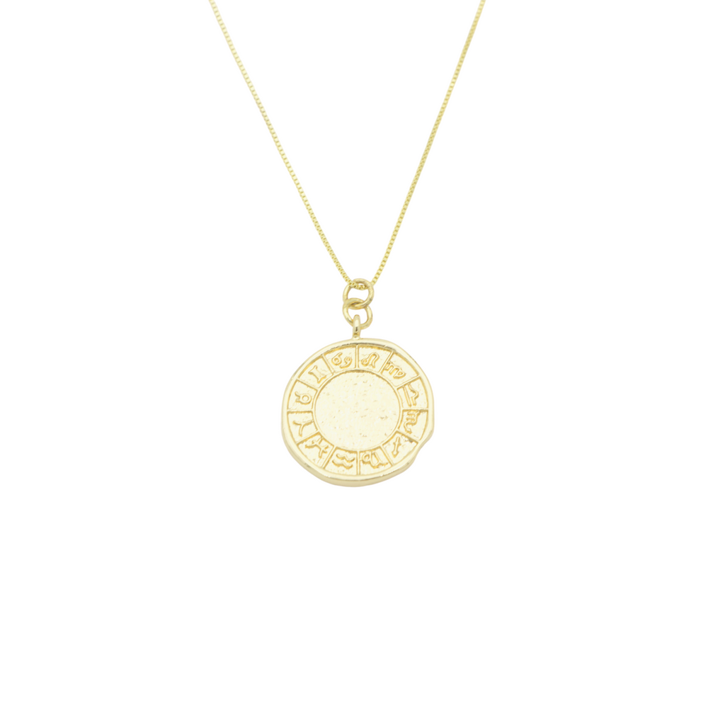 AW Boutique's gold filled 18 inch box chain featuring a rustic zodiac coin featuring all the astrology signs. The pendant has a rustic, hammered effect around the edge and across the face of the pendant.