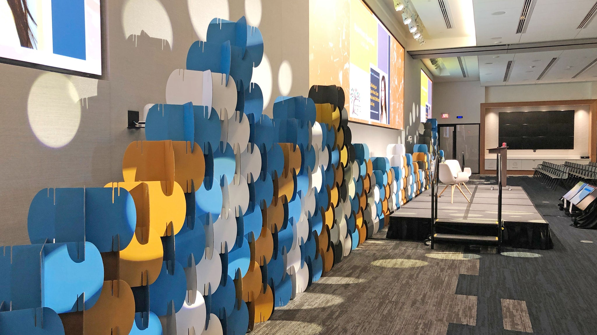 Nomad System as backdrop wall closeup at Capital One event.