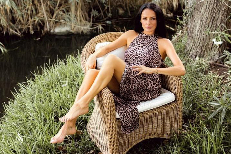 Virginia Macari in her Leopard dress handmade from sustainable fabric.