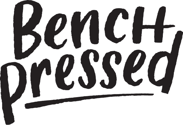 Bench Pressed logo black hand lettered logo of company name with underline