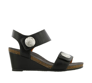 Outside angle of Black Leather wedge sandal featuring hook and loop straps and rubber outsole - size 36