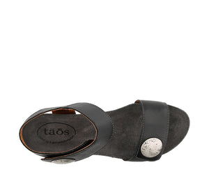 Top down angle of Black Leather wedge sandal featuring hook and loop straps and rubber outsole - size 36