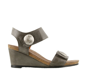 Outside angle of Graphite wedge sandal featuring hook and loop straps and rubber outsole - size 36