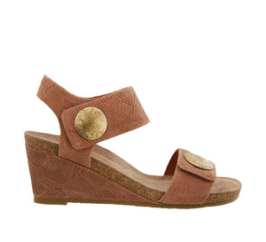 Outside angle of Blush Embossed Suede wedge sandal featuring hook and loop straps and rubber outsole - size 36