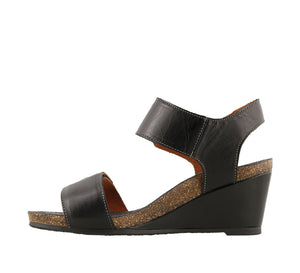 Instep angle of Black Leather wedge sandal featuring hook and loop straps and rubber outsole - size 36